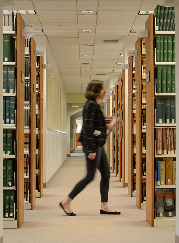 woamn walking through UConn law library